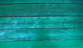Pintura verde fresca en el fondo de madera Foto de archivo