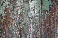 Pintura verde vieja en los tableros Fotos de archivo