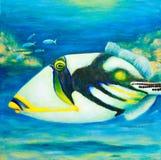 Pintura vibrante de un pescado del disparador en un filón coralino fotos de archivo