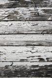 Pintura vieja que pela de tablones de madera foto de archivo