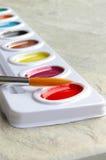 Pintura y cepillo Fotografía de archivo libre de regalías