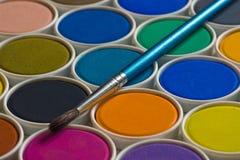 Pintura y cepillo de la acuarela Imagen de archivo libre de regalías