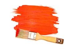 Pintura y cepillo rojos Fotos de archivo