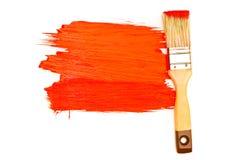 Pintura y cepillo rojos Foto de archivo libre de regalías
