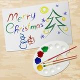 Pintura y paleta de la Feliz Navidad foto de archivo