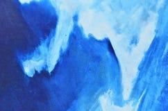 Pinturas brancas e azuis da aquarela na lona Imagem de Stock