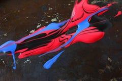 Pinturas brilhantes na superfície do grunge Imagem de Stock
