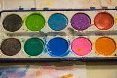 Pinturas coloridas do bebê Fotografia de Stock