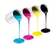 Pinturas da cor da tinta de Cmyk em umas latas Imagem de Stock