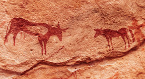 Pinturas da rocha no deserto de Sahara, Argélia Imagens de Stock Royalty Free