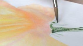 Pinturas de la acuarela de la pintura del artista almacen de metraje de vídeo