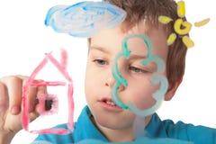Pinturas del niño sobre el vidrio Fotos de archivo