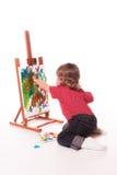 Pinturas do dedo da criança na armação fotos de stock