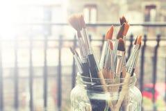 Pinturas e escovas Imagem de Stock