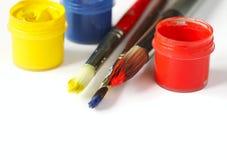 Pinturas e escovas Fundo da arte e do ofício imagens de stock
