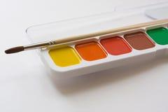 Pinturas e uma escova Imagem de Stock Royalty Free