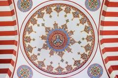 Pinturas restauradas en la pared interior de una bóveda de la mezquita Foto de archivo
