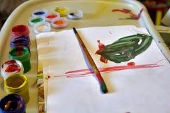 Pinturas y cepillo de los niños Imagen de archivo