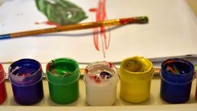 Pinturas y cepillo de los niños Imagen de archivo libre de regalías