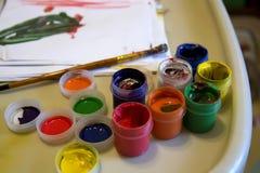 Pinturas y cepillo de los niños Imágenes de archivo libres de regalías