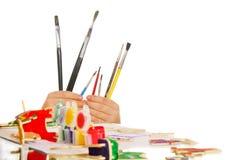 Pinturas y cepillos Imagenes de archivo