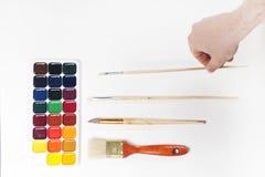 Pinturas y cepillos de la acuarela Imagen de archivo