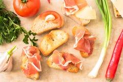 Pintxos with prosciutto and tomato Royalty Free Stock Photography