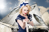 Pinup american military girl pulling sea anchor. Classic retro portrait of a blond american navy pinup girl reefing in an ocean anchor with model hairstyle and Stock Image