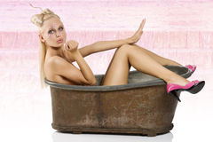 Pinup in bath with pink shoes Stock Photo