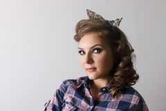 Pinup beautiful woman in checkered shirt Stock Image
