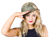 Pinup beauty saluting to a mission accomplished Stock Photos