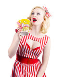 Pinup cinema girl at box office movie premiere. Vintage pinup cinema girl holding movie tickets and popcorn box looking up a film copyspace with surprised Stock Photos