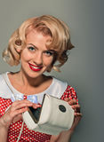 Pinup coquettish woman and purse Royalty Free Stock Photography