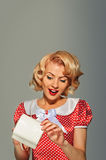 Pinup coquettish woman with purse Royalty Free Stock Images