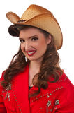 Pinup Cowgirl. Cowgirl pinup in vintage red jumper, cowboy hat, cowboy boots and six shooter Royalty Free Stock Photo