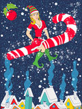 Pinup elf riding candy cane Stock Images