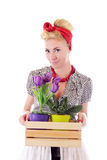 Pinup flower woman holding some pots Royalty Free Stock Photos