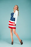 Pinup girl with american flag Royalty Free Stock Photos