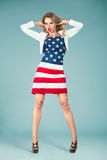 Pinup girl with american flag Stock Images