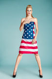 Pinup girl with american flag Royalty Free Stock Images