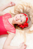 Pinup girl beautiful funny young blond woman happy smiling & looking at camera on white background closeup portrait Stock Images