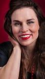 Pinup Girl in Black Dress Smiles Royalty Free Stock Photos