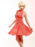 Pinup girl in blond wig and retro dress dancing Royalty Free Stock Images