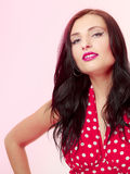 Pinup girl brunette woman in retro dress. Vintage. Stock Images