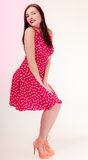 Pinup girl brunette woman in retro dress winking Royalty Free Stock Image