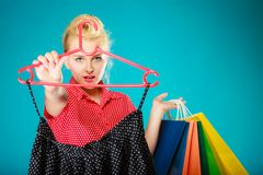 Pinup girl buying clothes black skirt. Sale retail Royalty Free Stock Photo