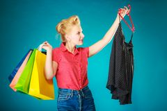 Pinup girl buying clothes black skirt. Sale retail Royalty Free Stock Images