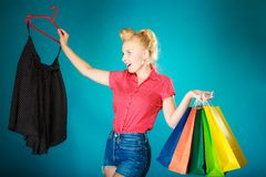 Pinup girl buying clothes black skirt. Sale retail Stock Images