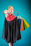 Pinup girl buying clothes black skirt. Sale retail Stock Photos