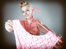 Pinup girl buying clothes pink dress. Sale Stock Photography